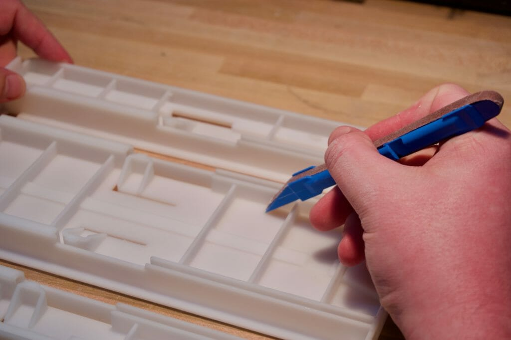 Model Making and 3D Printed Part Finishing - hand sanding small features on a somos NeXt tray